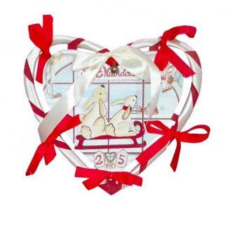 Corazón de Navidad con lazos
