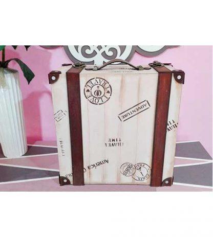 Caja en forma de maleta